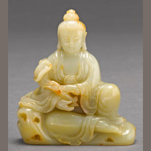 A jade carving of a seated Guanyin 20th century