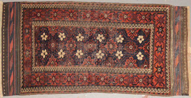 A Belouch rug size approximately 4ft. 4in. x 6ft. 7in.
