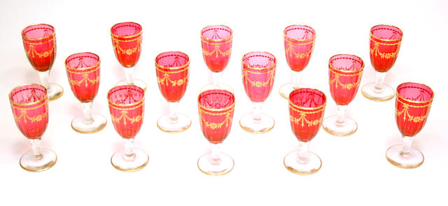 A set of fourteen cranberry glass wine glasses