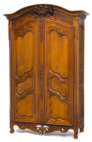 A Louis XV carved walnut armoire <BR />third quarter 18th century