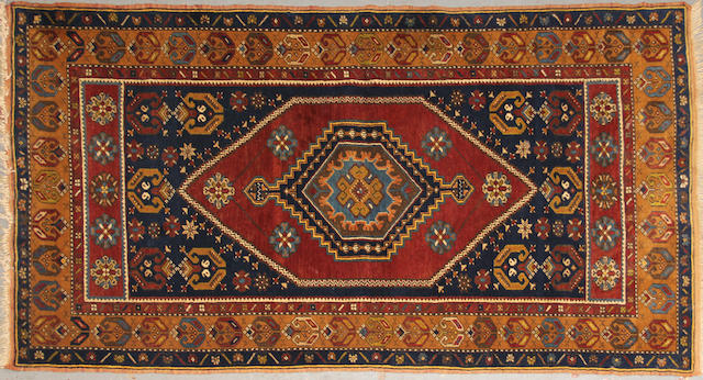 A Turkish rug size approximately 3ft. 10in. x 7ft. 3in.