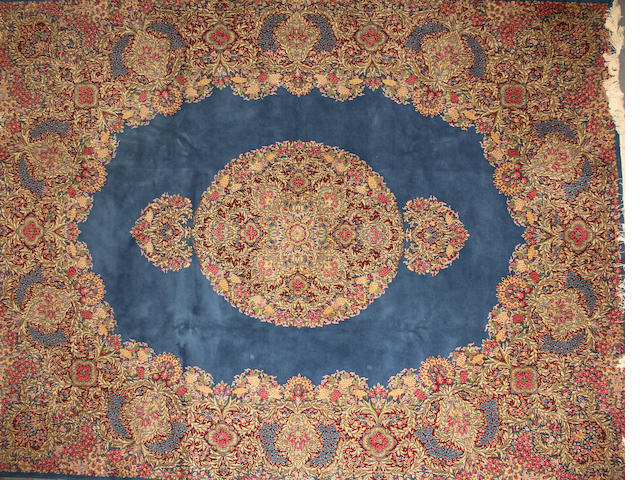 A Kerman carpet  size approximately 9ft. 10in. x 13ft. 3in.