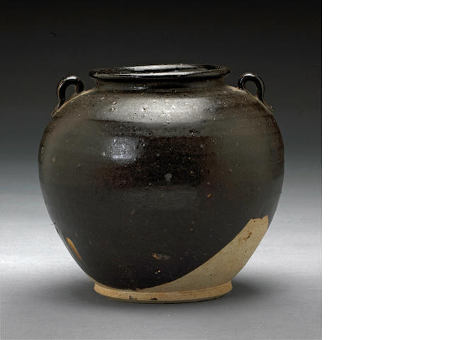A small dark brown glazed stoneware storage jar Tang dynasty