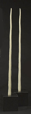 Two faux narwhal tusks on stands  attributed to Tony Duquette