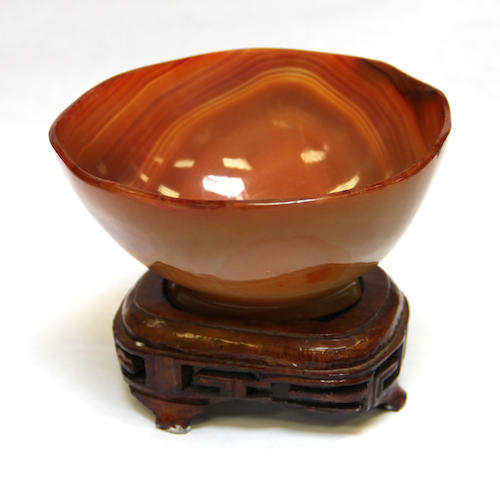 A Chinese carved carnelian libation cup