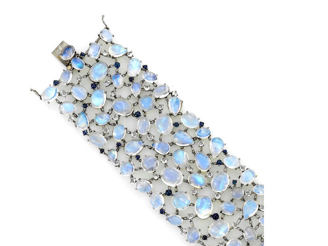 A moonstone, blue and white sapphire wide bracelet