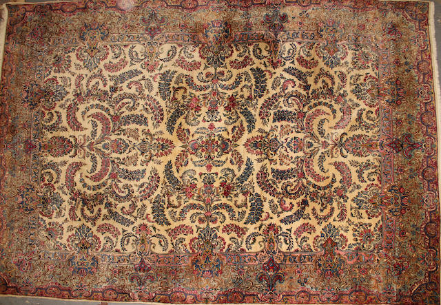 A Kerman carpet  size approximately 9ft. 10in. x 14ft. 5in.
