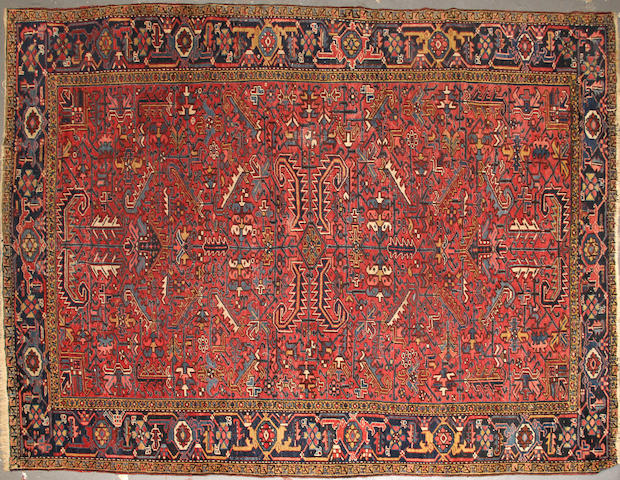 A Heriz carpet  size approximately 7ft. 8in. x 11ft.