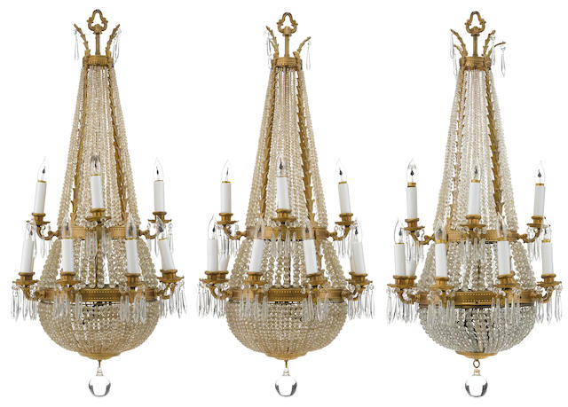 A suite of three Continental gilt metal and cut glass twelve light chandeliers  <BR />early 20th century