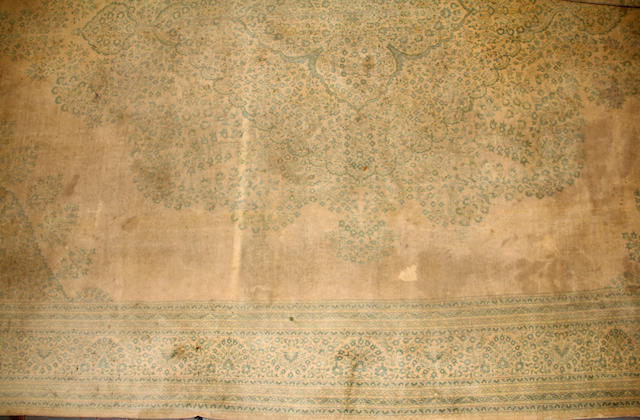 An Indian carpet  size approximately 14ft. 7in. x 20ft. 8in.