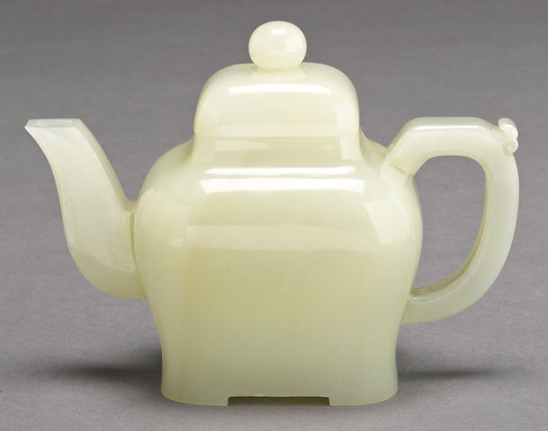 A greenish-white jade covered teapot