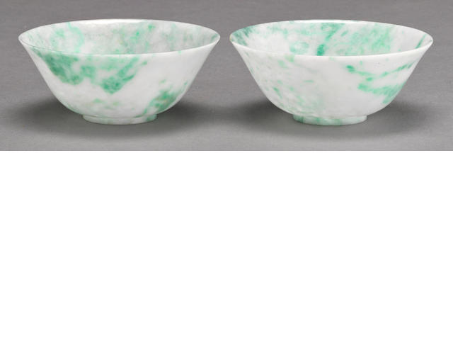 A pair of jadeite bowls with apple green highlights