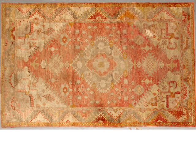 An Oushak rug  size approximately 4ft. 5in. x 7ft. 1in.