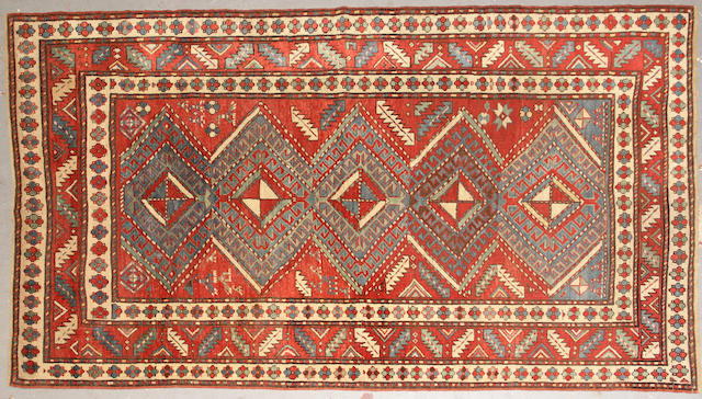 A Kazak rug  size approximately 5ft. 2in. x 8ft. 10in.