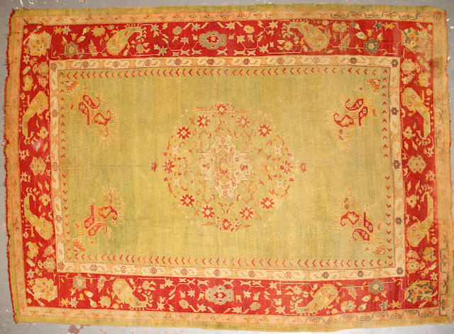 An Oushak carpet size approximately 8ft. 4in. x 11ft. 11in.