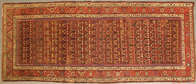 A Malayer long carpet  size approximately 4ft. 6in. x 11ft. 7in.