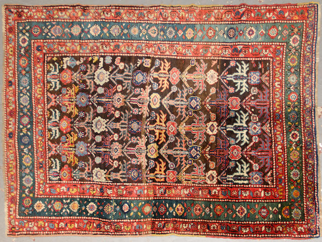 A Kazak rug  size approximately 4ft. 10in. x 6ft. 10in.