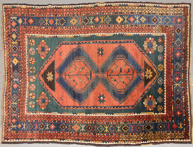 A Kazak rug  size approximately 4ft. 2in. x 6ft. 3in.