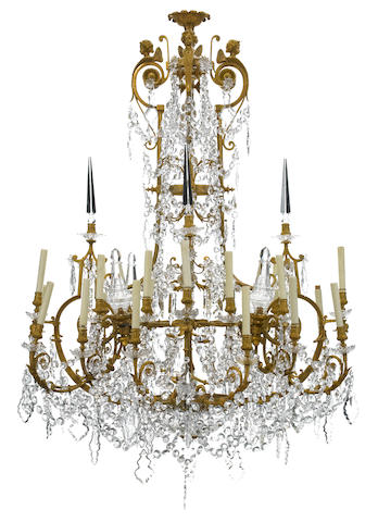 An imposing Louis XV style gilt bronze and cut glass thirty-two light chandelier