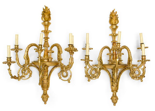 A pair of Neoclassical style carved giltwood five light bras de lumière  <BR />19th century