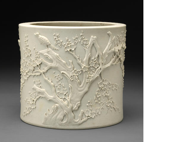A white biscuit porcelain brush pot with molded prunus design Wang Bingrong mark, Republic period