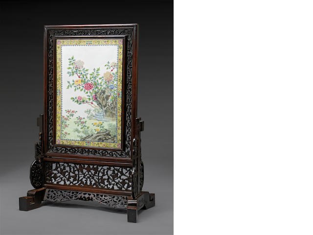 A reticulated wood table screen with famille rose enameled porcelain plaque Republic period