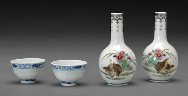 A pair of miniature blue and white porcelain wine cups with incised dragon decoration  Guangxu mark, Republic period