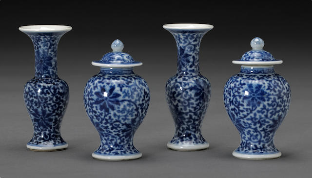 A set of four miniature blue and white porcelain vases 19th century