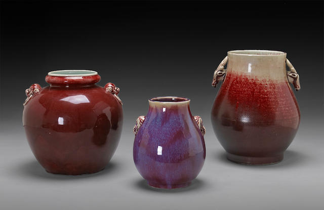 A group of three red glazed porcelain jars