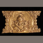 A Tibetan gilt copper repousse plaque of a Buddhist guardian figure 17th/18th century