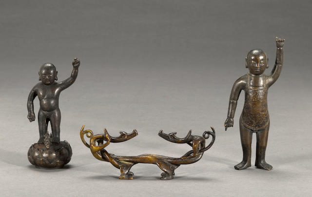 A group of three cast bronze decorations