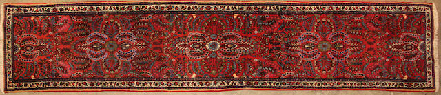 A Hamadan runner  size approximately 2ft. 8in. x 13ft. 2in.