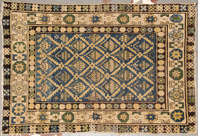 A Kuba rug size approximately 3ft. x 4ft. 3in.