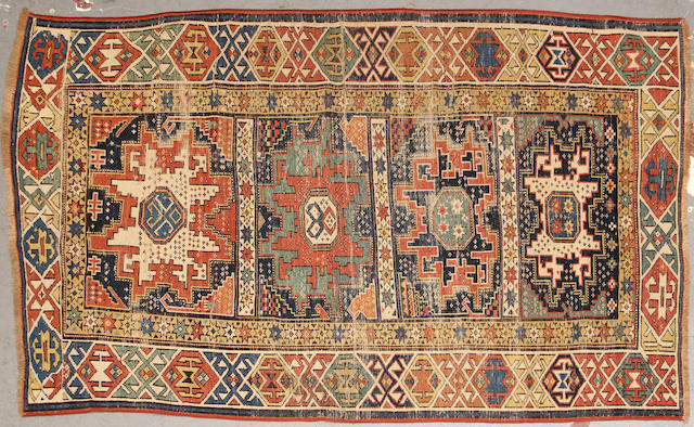 A Caucasian rug size approximately 3ft. 9in. x 5ft. 9in.