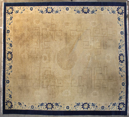 A Chinese carpet size approximately 8ft. x 10ft.