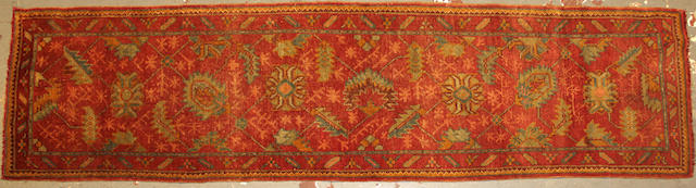 A Oushak runner  size approximately 3ft. 1in. x 12ft. 1in.