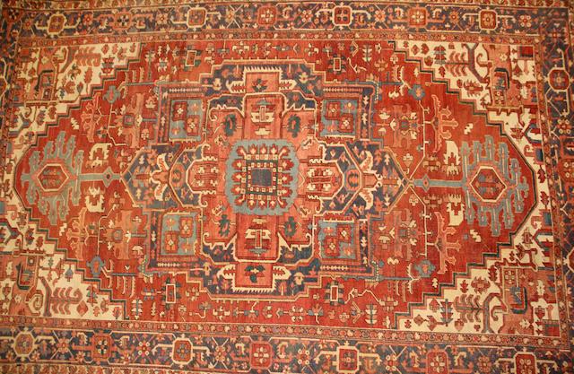 A Heriz carpet size approximately 10ft. 1in. x 16ft. 2in.