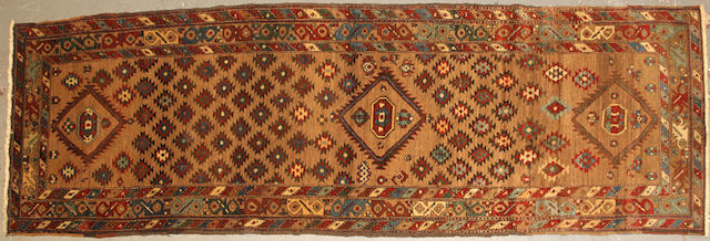 A Northwest Persian runner  size approximately 3ft. 7in. x 10ft. 1in.