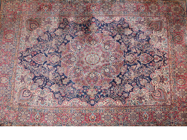 A Kerman carpet  size approximately 11ft. 5in. x 14ft. 10in.