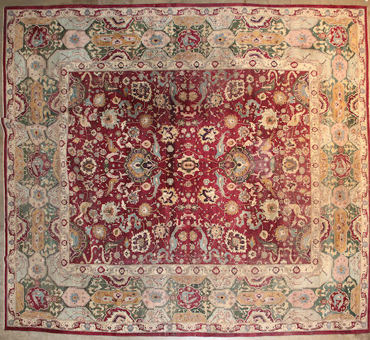 An Agra carpet size approximately 9ft. 7in. x 12ft. 3in.
