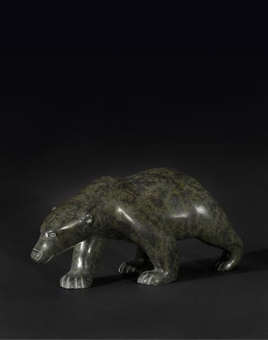 A Henry Evaluardjuk stone sculpture