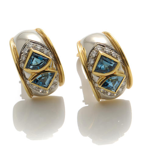 A pair of blue topaz, diamond and bicolor gold earrings