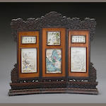 A hardwood three-panel table screen with enameled porcelain plaques 20th century