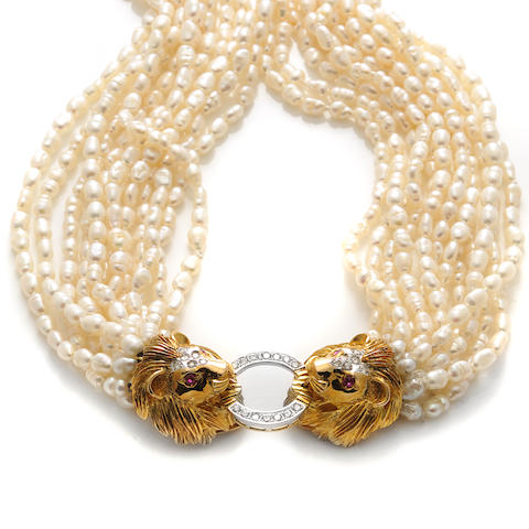 A rice pearl, diamond and 14k bicolor gold lion's head torsade necklace