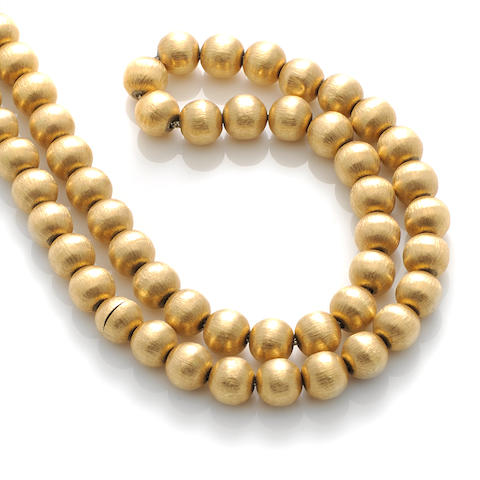 An 18k gold bead necklace