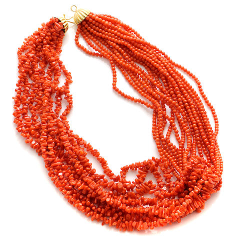A coral bead and gold torsade necklace