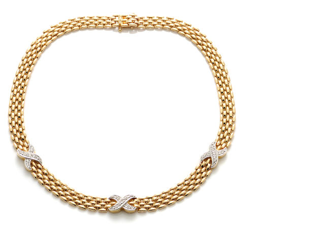 "A diamond and 14k gold ""X"" motif necklace"