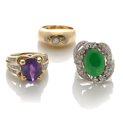 A collection of three gem-set, diamond, jade and gold rings