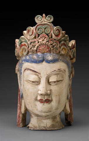 A carved wood head of Guanyin
