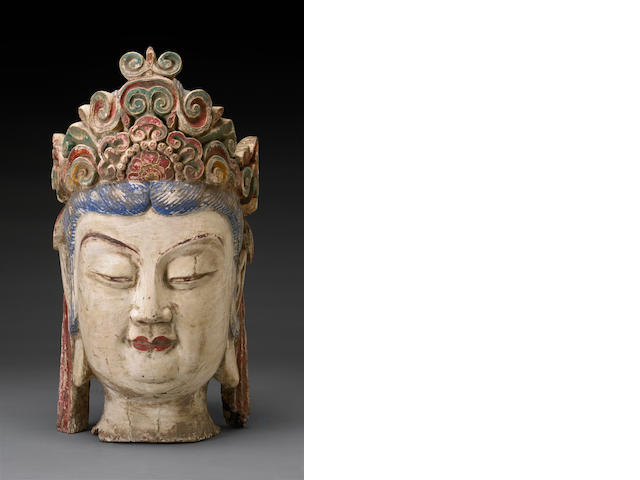 A carved wood model of the head of Guanyin